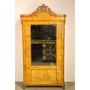 Superb Biedermeier period quality blond ashwood single door vitrine with original mirror plate. A nice feature is the...