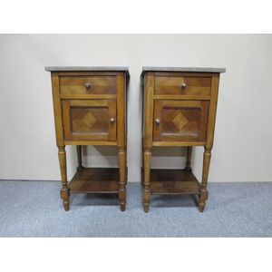 Pair of French walnut bedside cabinets each fitted with a drawer above a cupboard door with bookmatched fronts. Circa 1920. In...