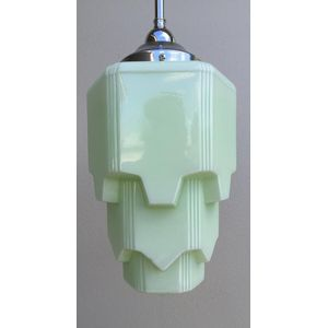 1930's deco pale green moulded glass skyscraper light shade. Comes complete with chrome rod suspension fittings and is ready to...