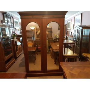 Antique mahogany twin mirrored door wardrobe . Sits on  plinth base main section with central division and large drawer on...