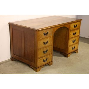 An antique executive desk  in blonde English oak. The massive top has been beautifully polished and has a lovely golden hue....