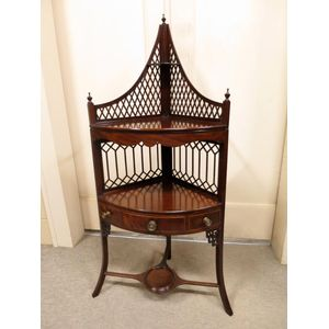 Mid-19th century mahogany and flame mahogany corner 2-tier washstand, featuring string inlay and stunning fretwork. Circa 1860....