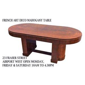 A mahogany art deco dining tab