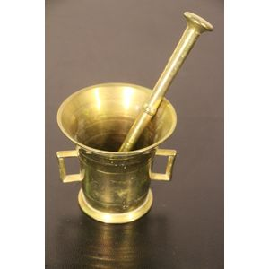 A well polished brass mortar and pestle. the Mortar with cast handles or lugs for heavy duty crushing . The pestle with turned...