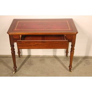 An antique Victorian mahogany writing desk or hall table with fitted single length drawer in apron. The gilt edge tooled...