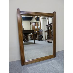 Edwardian wall mirror with a fluted walnut frame.  In detailed condition. Circa 1910.