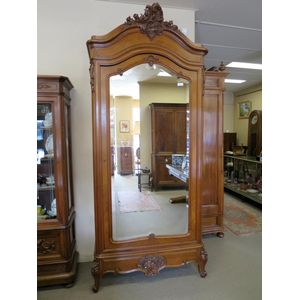 A beautiful 19th century French walnut armoire in the Louis XV style, featuring book matched sides and well carved details. The...