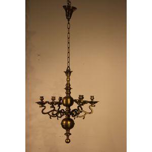 A heavy solid bronze chandelie