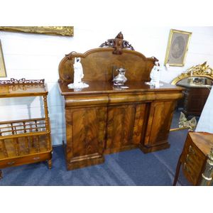 Victorian flame mahogany sideboard the base having 3 doors the left-hand door opens to reveal two pull-out shelves and the...