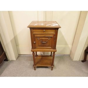 French walnut bedside cabinet in the Louis XVI style, finely detailed and retaining original inset marble top. Circa 1900.