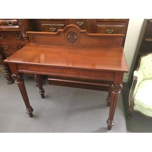 Solid Mahogany Neo Classical Hall Table with arch top rail back, carved motif, moulded apron, tapering and fluted legs with...