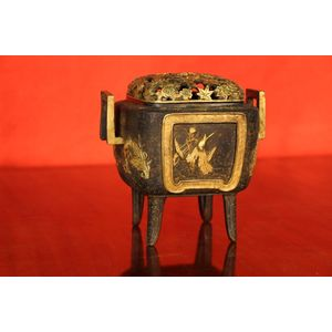 A signed, well carved and cast bronze incense burner with different scenes to each side, highlighted in gilt bronze. . The lift...