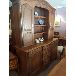 Fabulous french oak dresser buffet ,base with three bowfronted drawers and door either side . Top with single door cabinet...
