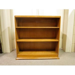 An English oak open bookshelf featuring quality construction and shelving fixed at graduating heights. In good original...