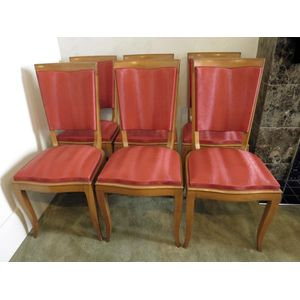 Set of 6 French Art Deco oak dining chairs retaining the original upholstery and in good detailed condition. Circa 1940.