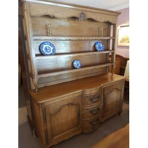 Fabulous french oak provincial dresser. Base with bow fronted drawers with substantial iron handles . Two doors cabi et .Upper...