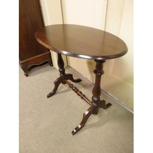 Late 19th century oval occasional table on a turned stretcher base. In excellent restored condition. Circa 1890 - 1900.