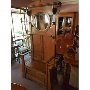 Classic english oak arts&crafts hallstand/seat . Great shoe storage ,round bevilled mirror ,original hooks a lovely deep golden...