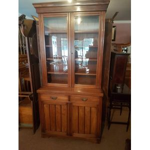 Antique australian cedar bookcase . Two glass doors,four adjustable shelves .Two drawers two door cabinet below,two parts for...