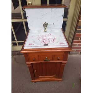 Antique french pitch pine cabinet with 2 little drawers and door below .Pretty decorated basin with brass lever tap .Marble...