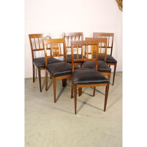 A set of four plus two antique Empire dining chairs with woven horsehair seats. The elegant backs curve outwards to support the...