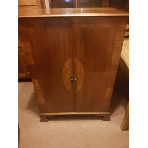 Art-deco walnut two door smaller wardrobe . Slide out hanging rod ,hooks two drawers compact and handy in great condition ....