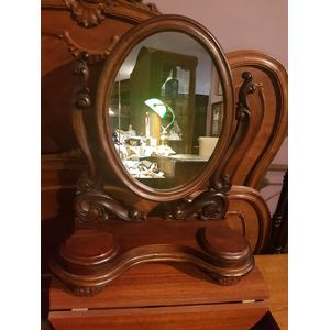 Antique cedar dressing mirror . Two liftup compartments ,oval swivel mirror in great condition .