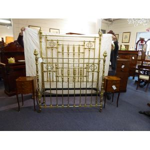 A Victorian solid brass bed, double size, with cast iron long rails in lovely condition.  The height of the bedhead (to top of...