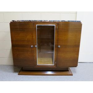 An excellent French Art Deco buffet in rosewood, retaining the original Portoro marble top and featuring a central glazed door,...
