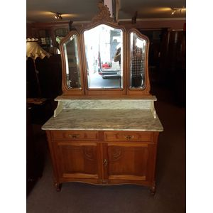French golden oak two drawer two door cabinet with carrara marble top . No chips or cracks with upper three panel bevilled...