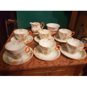 Shelley england fine bone china 14 pce teaset . 6 cups and saucers milk jug and sugar bowl .2 cups have internal hairlines ....