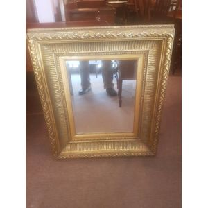 Baroque influence bevilled wall mirror .Substantial gold coloured frame with great detail . Hanging chain . In excellent...
