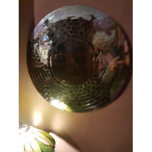 Round wall mirror many small p