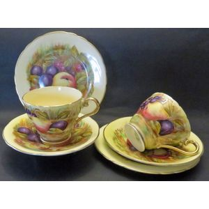 I have two of these Aynsley Golden Orchard cups, saucer and plates with the facsimile signature of D. Jones. Both are in...