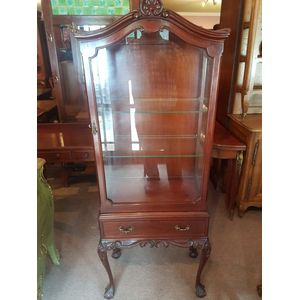 Australian cedar single door display cabinet ,made by Edward Bishop Malvern Sa . Drawer below fine carving and in excellent...