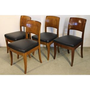 A set of four antique Imperial Russian chairs in the Biedermeier Empire manner. Each with well shaped ergonomic backs in full...
