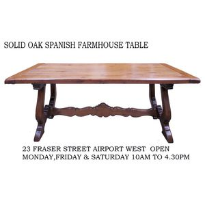 A rustic Spanish solid oak table with stretcher and lyre ends. In lovely detailed condition. Warehouse open Monday, Friday &...