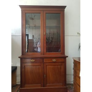 Fine quality edwardian cedar turn of the century bookcase. Attractive clean lines with original glass, brass metal ware....