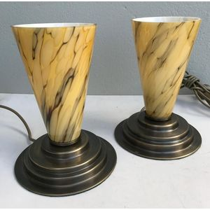 Pair of stepped solid brass lamp bases with aged patina finish and original Czech deco yellow/brown marbled glass cone shades....