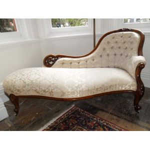 Mahogany chaise cosisting of spoon back,button back ,serpentine front beutifully carverd and upholstered in quality fabric in...