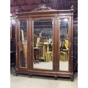 A fine quality mahogany armoire/wardrobe in lovely original condition. Three mirrored doors, all beveled, elegant proportions...