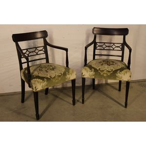 A large pair of English Georgian armchairs in the Hepplewhite manner. Fully carved in solid mahogany and with excellent...