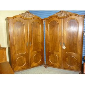 Two identical attractive Austrian/French armoires wardrobes featuring 2 humps and carved top, 2 doors with arched and round...