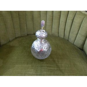Very nice sterling silver mounted pefume bottle with a large