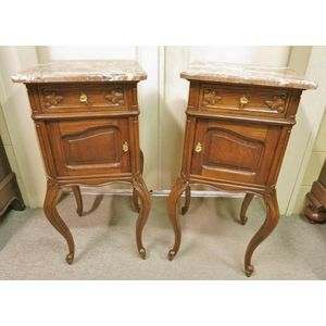 A beautiful pair of French oak marble top bedside cabinets. In mellow detailed condition retaining aged colour and silky to the...