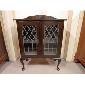 A delightful 1930's small 2-door side cabinet with original leadlight panels. In good original condition.
