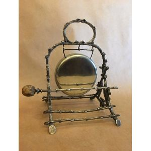 A unique detailed silver plated circa 1900 dinner gong, with original pig skin covered hammer by Walker and Hall. Excellent...