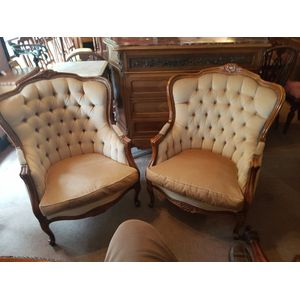 Very nice pair of french walnut bergeres ,covered in neutral tan coloured fabric . Buttoned a fine looking pair of armchairs in...