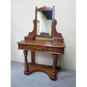 Victorian mahogany and flame mahogany dressing table with a rectangular swinging mirror, pair of trinket drawers and turned...