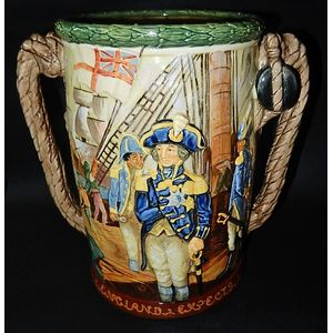 A Royal Doulton loving cup issued in 1935 celebrating Nelson's victory designed by Harry Fenton and Charles Noke. It is number...